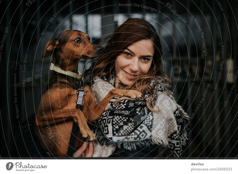 Loving pets Lifestyle Joy Human being Feminine Young woman Youth (Young adults) Woman Adults Friendship 1 30 - 45 years Town Door Street Scarf Animal Pet Dog