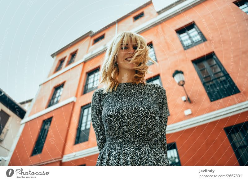 Happy young woman with moving hair in urban background. Woman Human being Youth (Young adults) Summer Beautiful White 18 - 30 years Street Lifestyle Adults