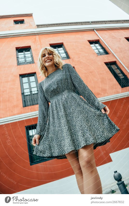 Funny young blonde woman standing on urban background. Lifestyle Style Joy Happy Beautiful Hair and hairstyles Human being Feminine Woman Adults