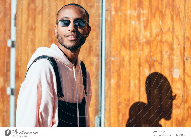 Young black man wearing casual clothes and sunglasses outdoors Lifestyle Happy Beautiful Human being Masculine Young man Youth (Young adults) Man Adults 1