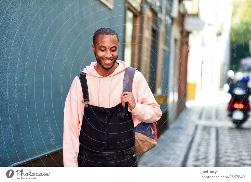 Young black man walking smiling down the street. Human being Youth (Young adults) Man Beautiful Young man Black 18 - 30 years Street Lifestyle Adults Happy