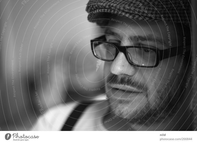 portrait Human being Masculine Young man Youth (Young adults) Head Face 1 18 - 30 years Adults Eyeglasses Cap Black-haired Facial hair Moustache Moody