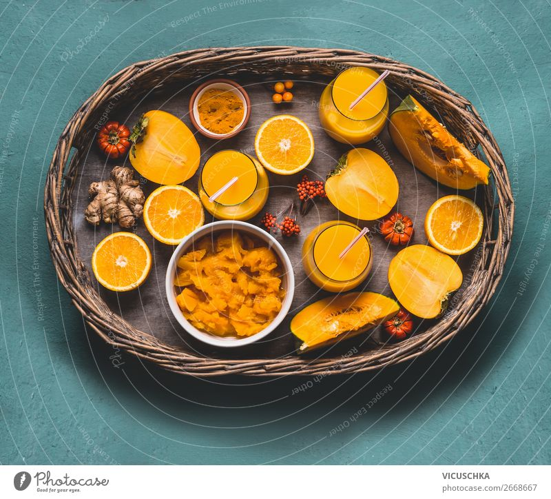 Healthy pumpkin smoothie on tray with ingredients Food Vegetable Fruit Herbs and spices Nutrition Organic produce Vegetarian diet Diet Beverage Juice Mug Glass