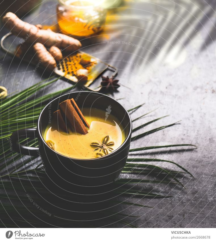 Cup of golden turmeric milk with spices Food Herbs and spices Nutrition Organic produce Diet Beverage Hot drink Milk Tea Style Design Healthy Health care