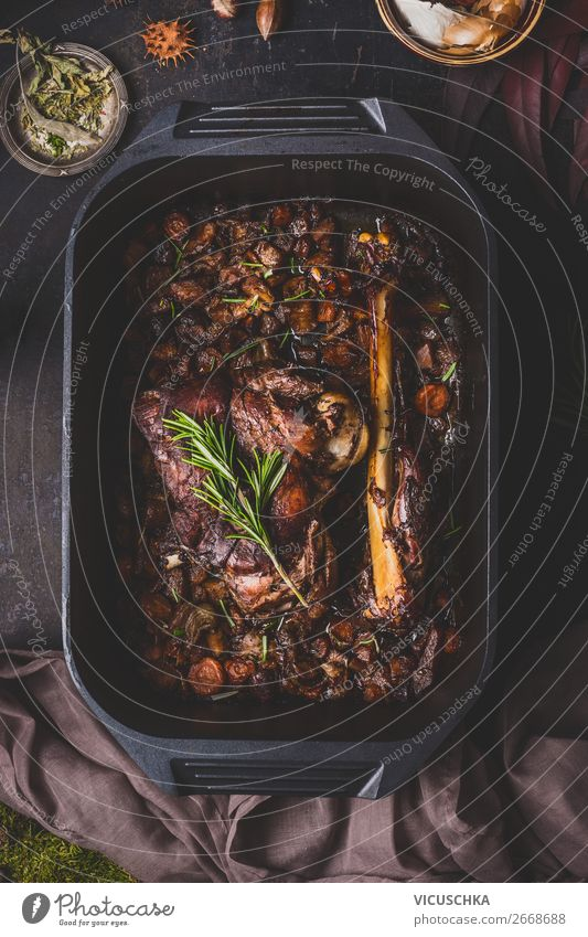 Slowly cooked roast venison in a cast iron pan Food Meat Herbs and spices Nutrition Dinner Banquet Organic produce Crockery Style Design Living or residing