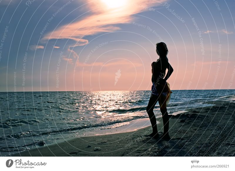 Teenage girl on the sea beach at sunset Woman Sky Nature Youth (Young adults) Blue Vacation & Travel Summer Ocean Beach Colour Loneliness Clouds Adults
