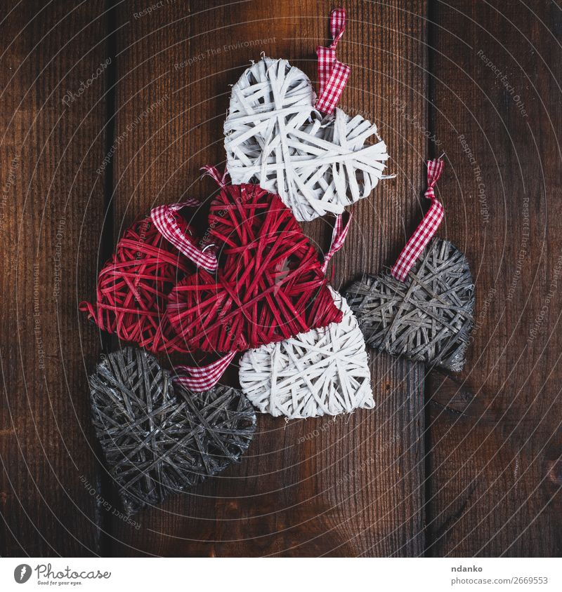 wicker small hearts on a brown wooden background Old Christmas & Advent White Red Wood Love Feasts & Celebrations Brown Gray Design Decoration Retro Heart