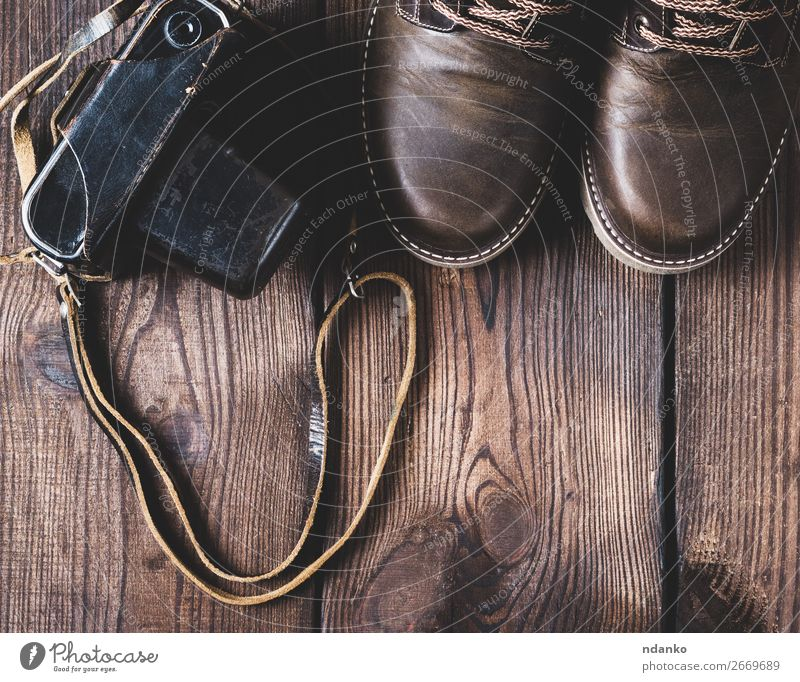 leather brown shoes and an old vintage camera Style Design Camera Feet Fashion Clothing Leather Footwear Wood Old Brown Top Vantage point Classic background