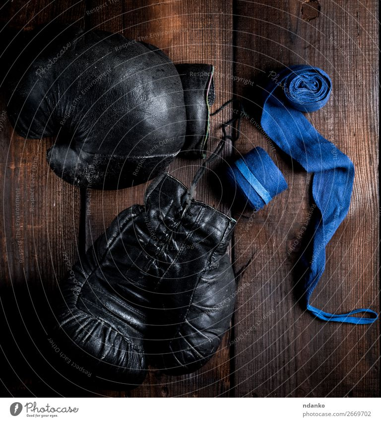 pair of very old black leather boxing gloves Lifestyle Fitness Sports Rope Leather Ring Gloves Wood Old Retro Blue Brown Black Protection Competition Might