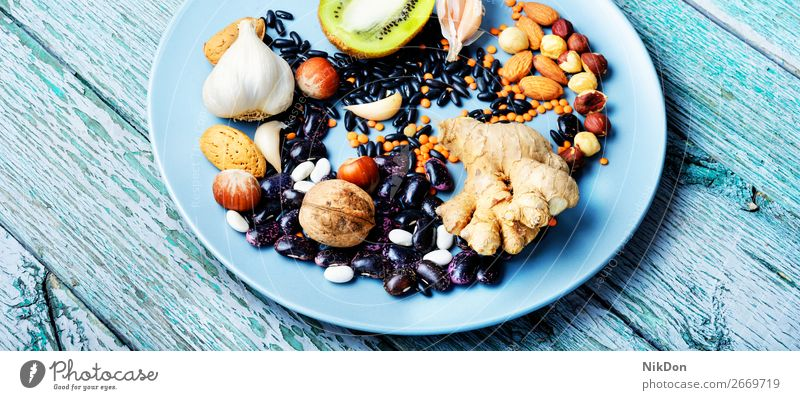 Health food concept healthy fruit antioxidant seed superfood vitamin lentils organic nutrition diet vegetarian vegetable ingredient protein berry medicine