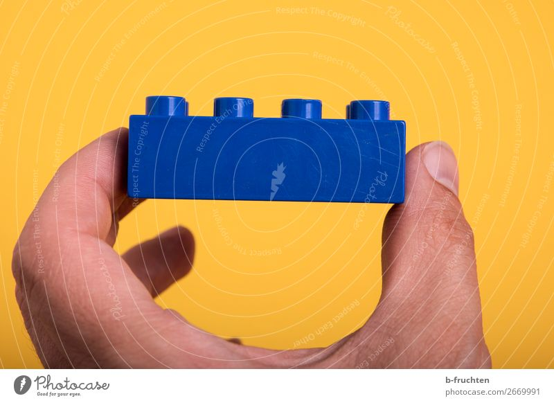 Game chip in hand Hand Fingers Toys Plastic Select Build Touch To hold on Blue Optimism Success Idea Teamwork Brick assemble Part Colour photo Interior shot