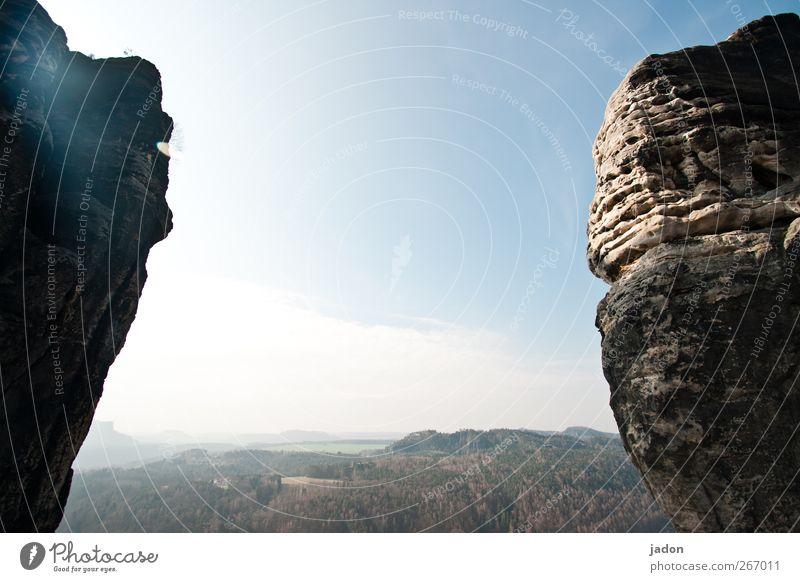 on the edge of a rock. Far-off places Mountain Sky Horizon Beautiful weather Rock Elbsandstone mountains Saxon Switzerland Infinity Bright Bizarre Eternity