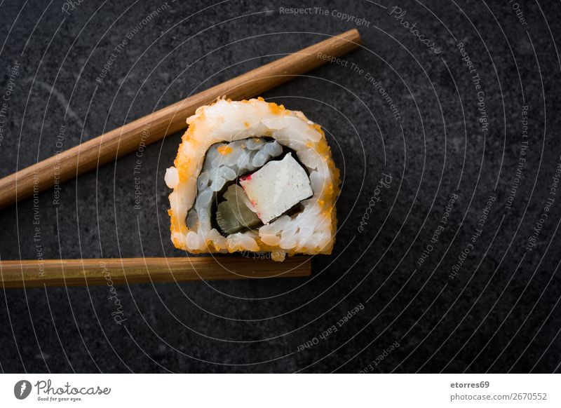 Chopstick with a sushi on black stone Sushi Food Healthy Eating Food photograph Japanese Rice Fish Salmon Seafood Roll Meal Make Gourmet Asia Raw Seaweed Dinner