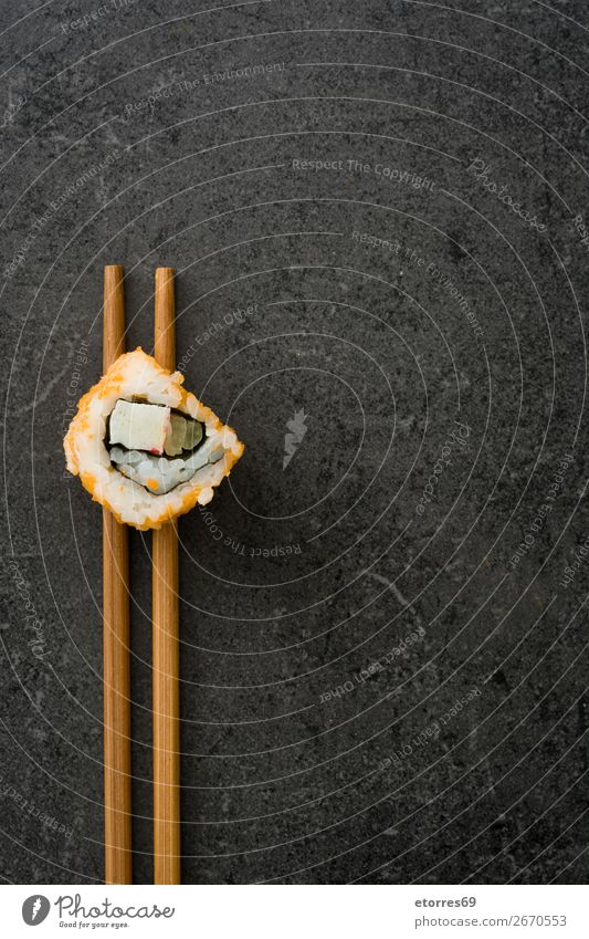 Chopstick with a sushi on black stone. Sushi Food Healthy Eating Food photograph Japanese Rice Fish Salmon Seafood Roll Meal Make Gourmet Asia Raw Seaweed