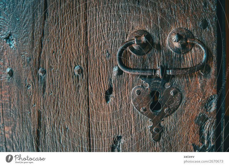 Detail of a lock and a handle of a medieval wooden door captured from the front Design Vacation & Travel Tourism House (Residential Structure) Decoration