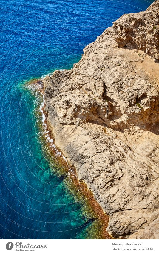 Aerial view of a rocky coastline, Mallorca. Vacation & Travel Adventure Far-off places Summer Ocean Waves Nature Landscape Rock Coast Blue water background