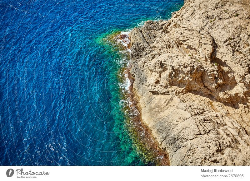 Aerial view of a rocky coastline, Mallorca. Vacation & Travel Summer Ocean Waves Nature Landscape Rock Coast Blue Discover water background Spain Cap Depera