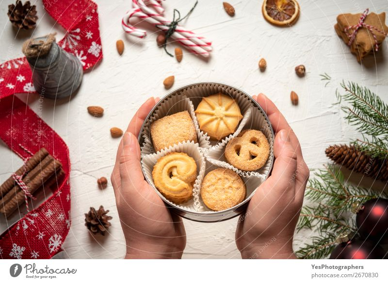 Woman holding cookies box above christmassy table Christmas & Advent Winter Feasts & Celebrations Decoration Sweet Delicious Candy Tradition Dessert
