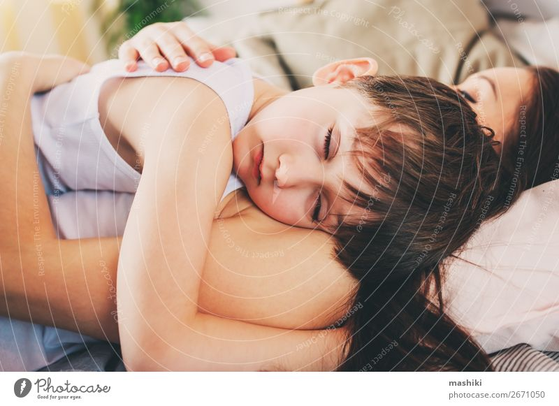 mother and child son sleeping together in bed Child Relaxation Joy Lifestyle Adults Love Emotions Family & Relations Boy (child) Together Smiling Infancy Sleep
