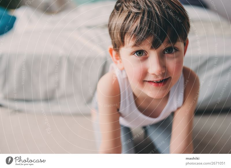 close up portrait of cute happy child boy Lifestyle Joy Happy Playing Freedom Bedroom Child Boy (child) Infancy Smiling Sleep Jump Authentic Small Cute Energy