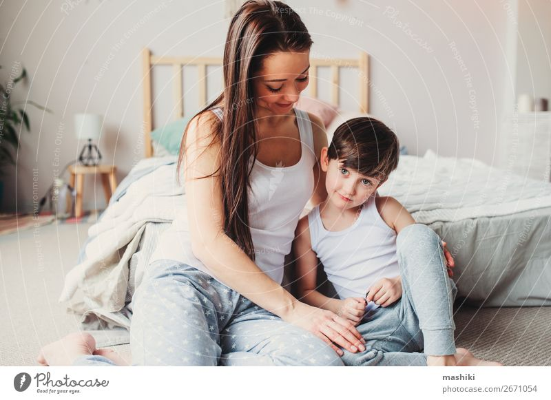 young happy mother comforting child son Child Toddler Boy (child) Parents Adults Mother Family & Relations Infancy Touch Love Sadness Embrace Small Emotions