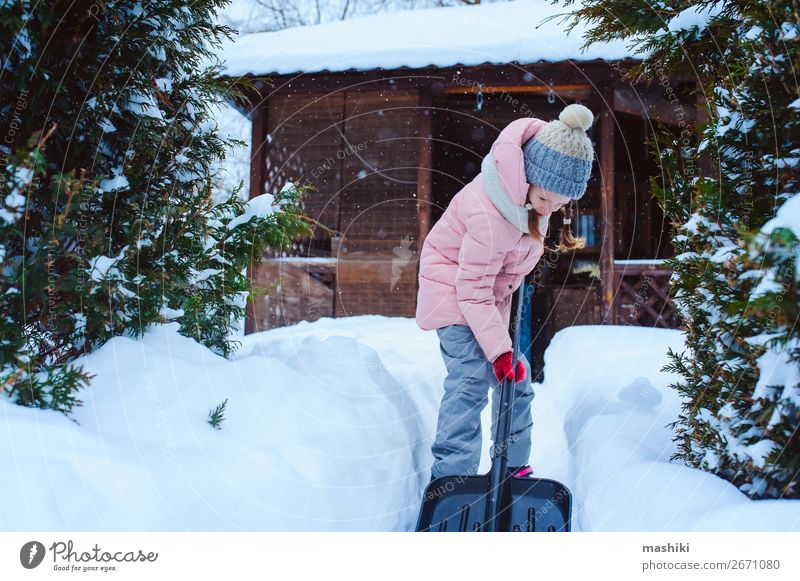 kid girl helping to clean pathway from snow Playing Winter Snow Winter vacation House (Residential Structure) Garden Child Tool Weather Storm Snowfall Happiness