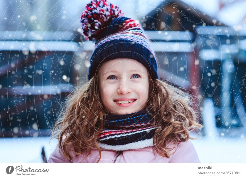 winter portrait of happy child girl playing outdoor Child Vacation & Travel Nature Christmas & Advent White Joy Winter Lifestyle Warmth Snow Happy Small Garden