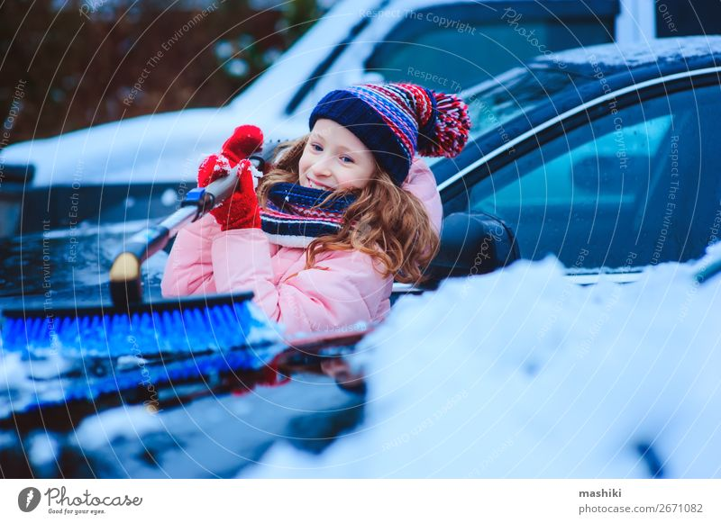 kid girl helping to clean car from snow Winter Snow Child Weather Bad weather Storm Snowfall Transport Street Vehicle Car Small Clean cold Frost Windscreen