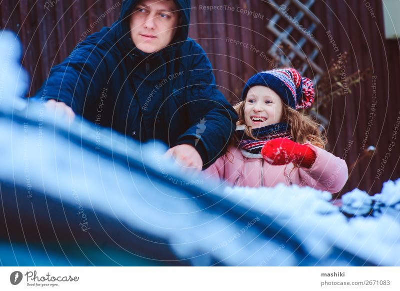 child girl cleaning car from snow with dad Winter Snow Child Tool Father Adults Family & Relations Weather Snowfall Transport Street Vehicle Car Together Clean