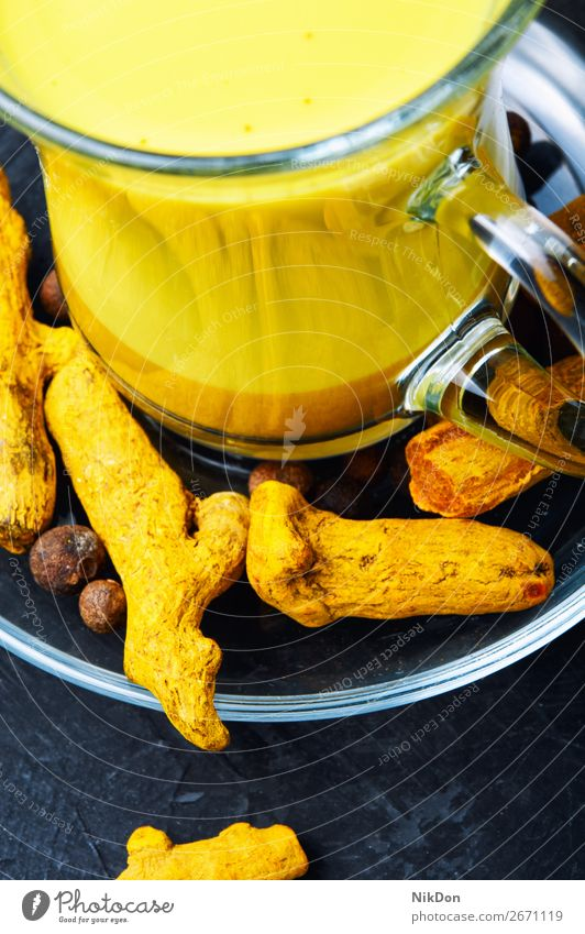 Healthy golden milk turmeric root medicine spice powder drink yellow remedy indian cinnamon healthy tea beverage detox herbal therapy curcumin cup glass ginger