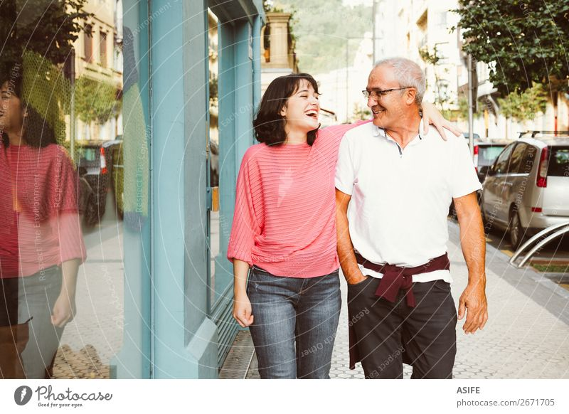 Father and daughter having fun together walking on the street Joy Happy Beautiful Woman Adults Man Parents Family & Relations Street Eyeglasses Smiling Laughter