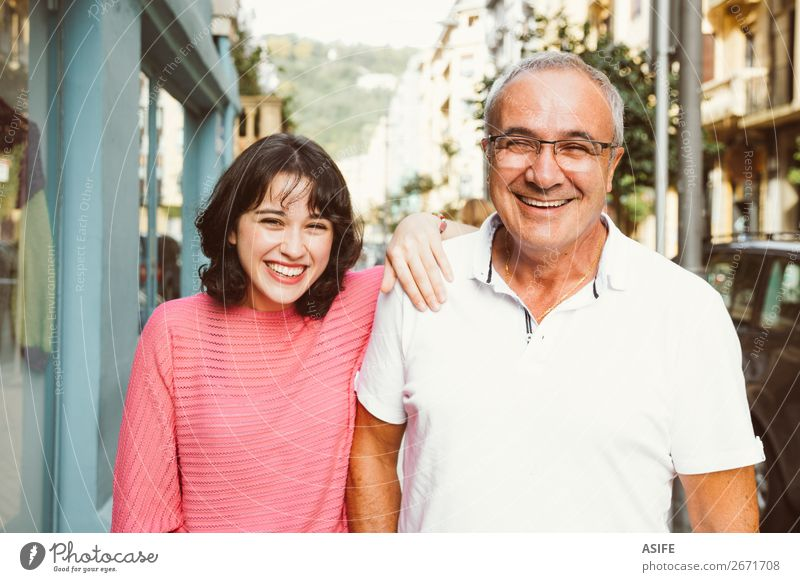 Father and daughter laughing together Joy Happy Beautiful Woman Adults Man Parents Family & Relations Street Eyeglasses Smiling Laughter Love Happiness Together