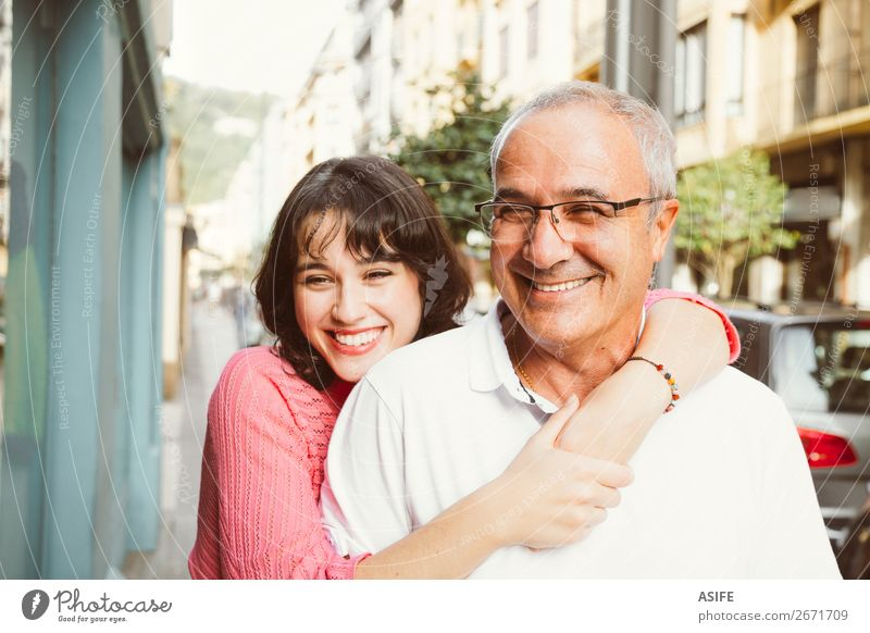 Portrait of happy father and daughter embracing on the street Joy Happy Beautiful Woman Adults Man Parents Father Family & Relations Street Eyeglasses Smiling