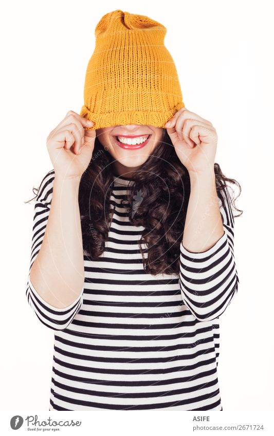 Happy autumn or winter girl covering face with wool cap Beautiful Winter Woman Adults Teeth Autumn Dress Smiling Happiness Funny Yellow Black White Wool