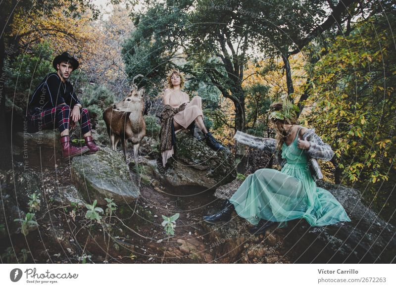 A Young group of friends Standing in the Woods and a Deer Lifestyle Elegant Beautiful Human being Masculine Feminine Androgynous Young woman