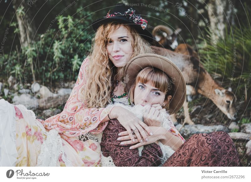 A Young Couple of Women in the woods Lifestyle Shopping Elegant Style Design Exotic Joy Human being Feminine Family & Relations Friendship Partner 2