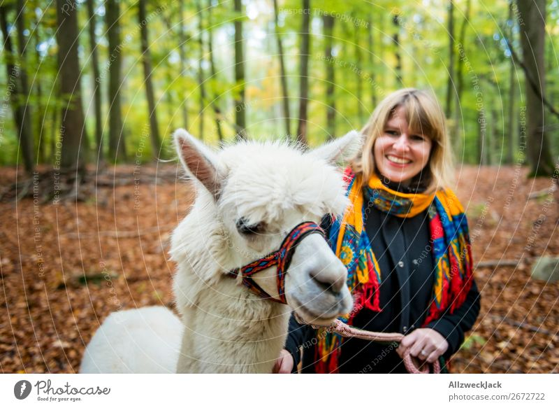 young woman leads white alpaca for a walk in the forest Trip Adventure Feminine Young woman Youth (Young adults) 1 Human being 18 - 30 years Adults Nature