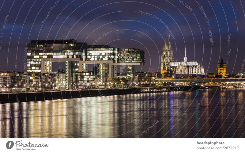 Night shots of the Kranhäuser, the Rhine and the cathedral in Cologne Germany Town Capital city Port City Downtown Skyline High-rise Dome Building Architecture