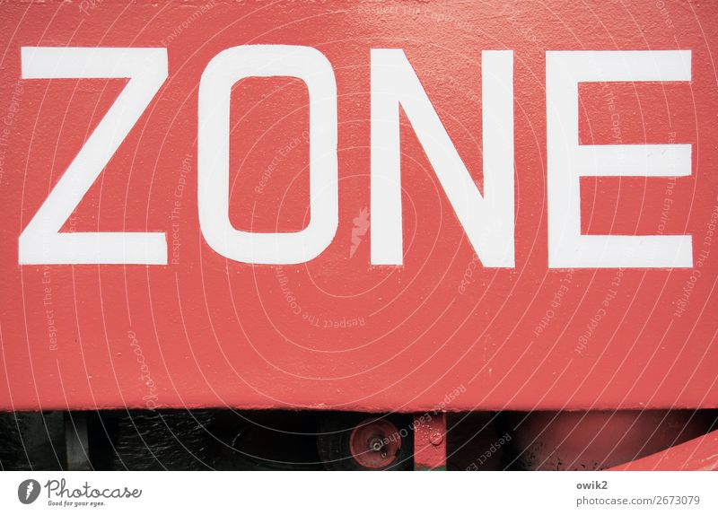 I.D., please! Zone Watercraft Hull Dye Metal Capital letter Large Red White Comprehensible Colour photo Exterior shot Detail Deserted Copy Space bottom