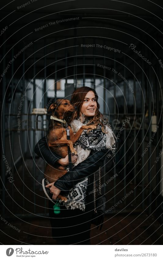 Woman with her dog in the arms. Lifestyle Vacation & Travel Human being Young woman Youth (Young adults) Adults Friendship 1 30 - 45 years England Europe Street