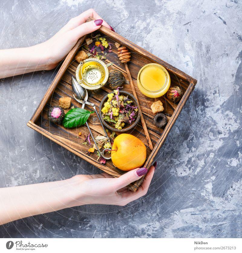 Assortment of tea leaves herb hands herbal healthy leaf flower drink green natural dry organic aroma box beverage antioxidant aromatic petal food hibiscus