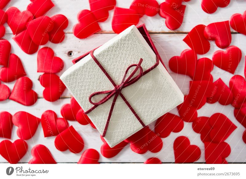 Red hearts and gift box on white wood Vacation & Travel Wood Love Feasts & Celebrations Heart Gift Romance Wedding Symbols and metaphors Concepts &  Topics