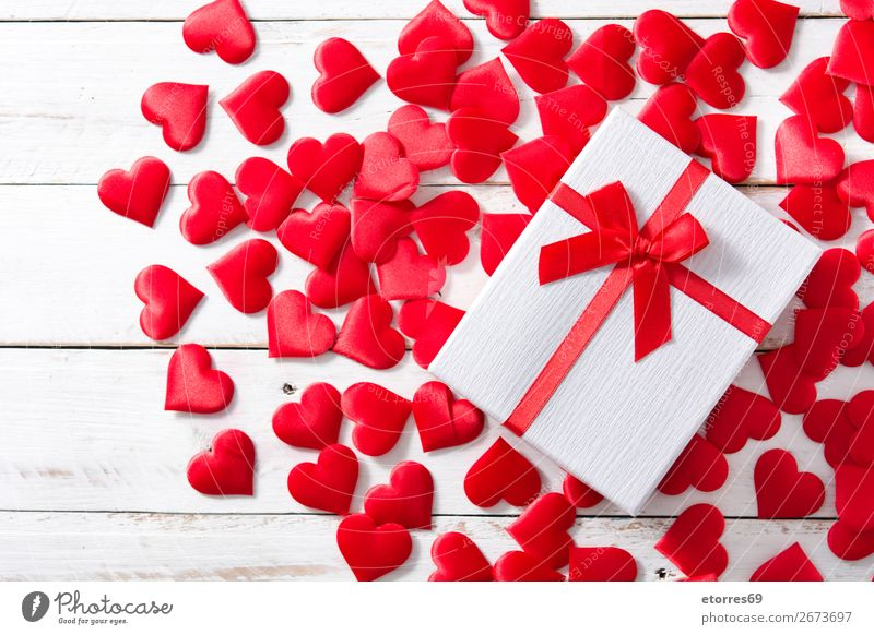 Red hearts and gift box on white wooden background. Heart Pattern Gift Neutral Background Love Valentine's Day Romance Vacation & Travel Feasts & Celebrations