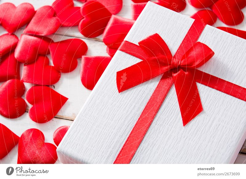 Red hearts and gift box on white wooden background. Vacation & Travel Wood Love Feasts & Celebrations Heart Gift Romance Wedding Symbols and metaphors