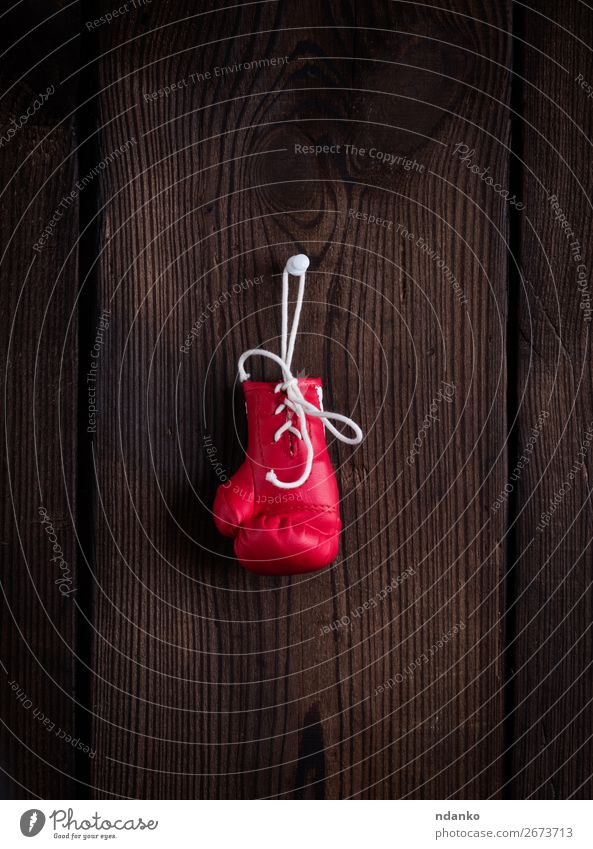 one leather red boxing glove with laces Old Red Wood Sports Brown Retro Fitness Protection Hang Rustic Retirement Conceptual design Competition Age Leather
