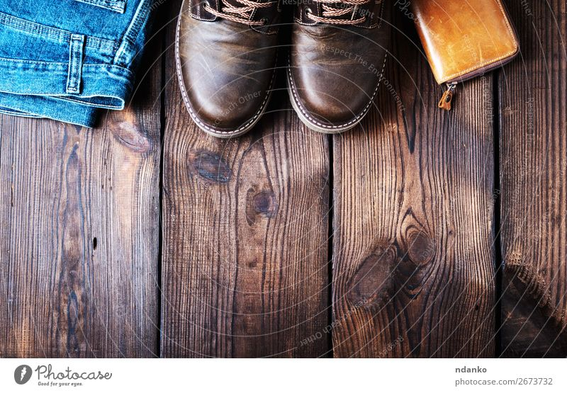 pair of leather brown shoes, wallet and jeans Elegant Style Design Feet Fashion Pants Jeans Leather Footwear Wood Old Dirty Dark Retro Blue Brown Colour Lace