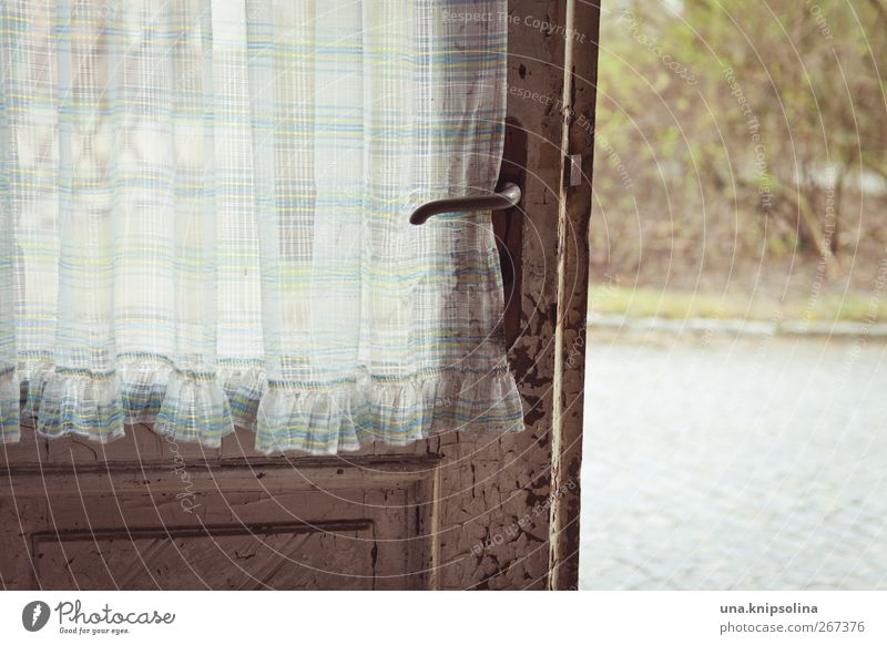 Open door Ruin Window Door Door handle Wood Metal Old Sharp-edged Broken Nostalgia Decline Past Transience Curtain Checkered Colour photo Subdued colour