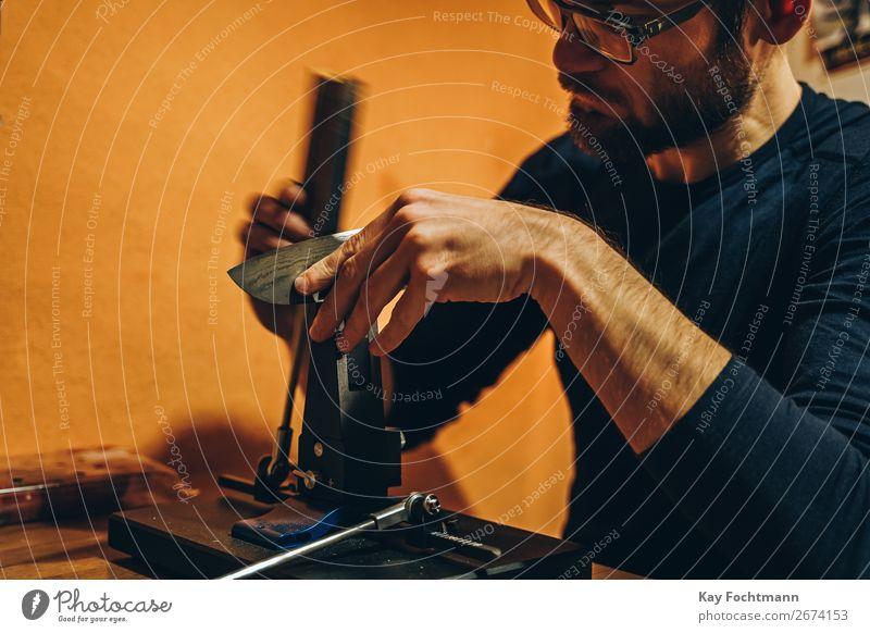 man sharpening knife abrasive beard blade closeup concentration cooking craft craftsman cut expertise grind grinder grinding hand hands handwork instrument