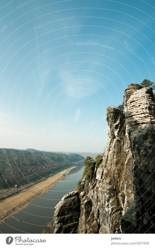 rock and river. Tourism Trip Sightseeing Landscape Sky Beautiful weather Rock Mountain Saxon Switzerland Elbsandstone mountains River bank Elbe
