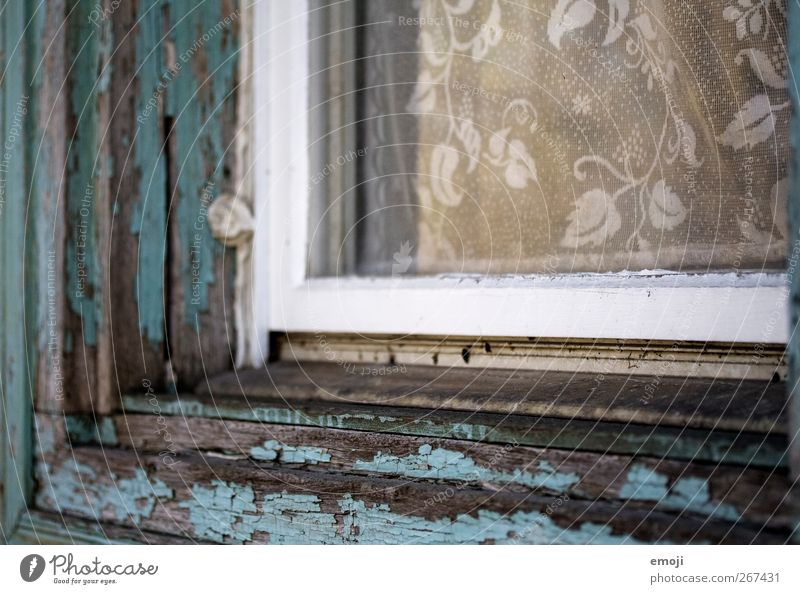 flake Wall (barrier) Wall (building) Facade Window Window pane Window board Window frame Curtain Old Turquoise Varnished Flake off Romanesque style Colour photo